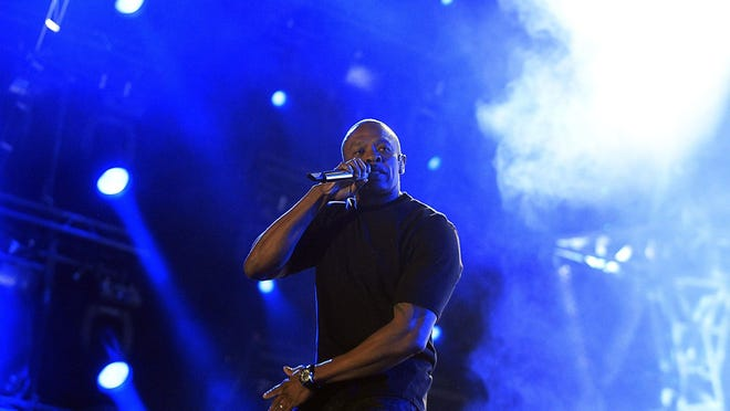 Dr. Dre performs with Snoop Dogg at the Coachella Music and Arts Festival in 2012.