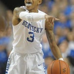 UK's Tyler Ulis calls a play during the University of Kentucky basketball game against Florida at Rupp Arena in Lexington, Ky., on Saturday, February 6, 2016.  Photo by Mike Weaver
