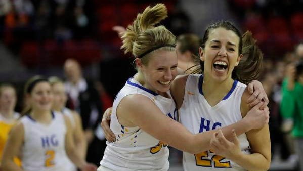 Howards Grove's Kaitlynn Near, left, and Samantha Yancy celebrate their 44-43 victory over La Crosse Aquinas during the WIAA Division 4 girls state basketball tournament final Friday, March 10, 2017, at the Resch Center in Ashwaubenon.