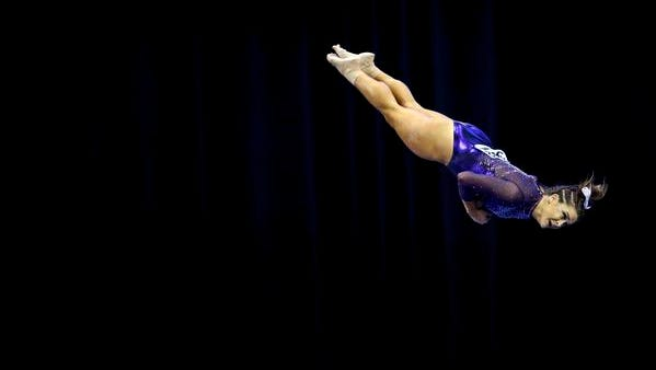 LSU gymnast Sydney Ewing competes on the balance beam during the team finals of the 2016 NCAA Women's Gymnastics Championships in Fort Worth, Texas. Ewing and her LSU teammates will attempt to win the school's first gymnastics national title beginning at 7 p.m. Friday in St. Louis at the NCAA Championships on ESPNU.