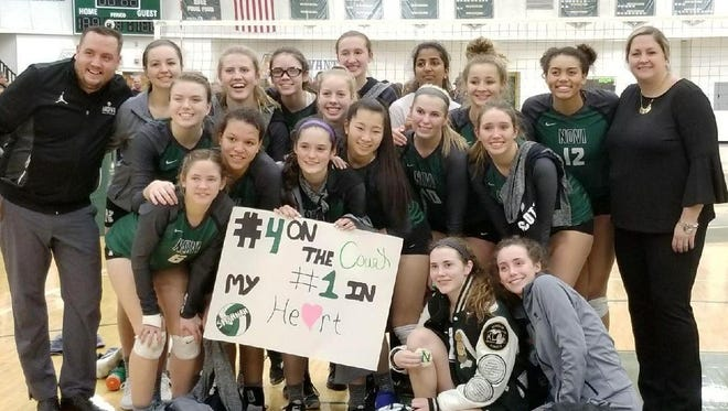 The Novi girls volleyball team is all smiles after a three-set Class A quarterfinal win over Temperance Bedford.