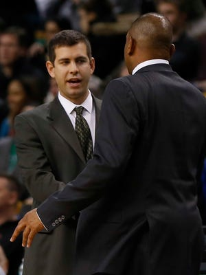 Celtics coach Brad Stevens greets the man he replaced, Clippers coach Doc Rivers, on Dec. 11, 2013.