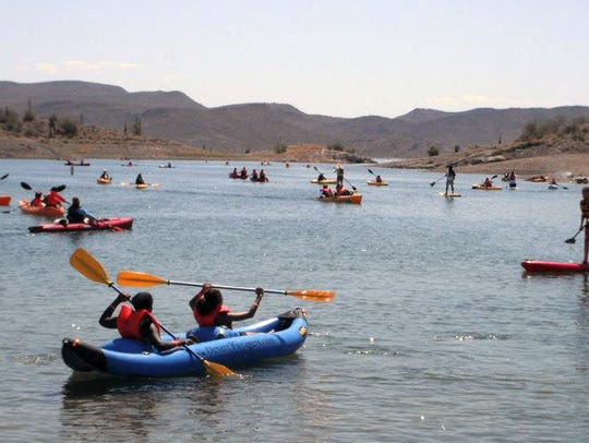 Kayakers abound at Paddle Fest at Lake Pleasant.