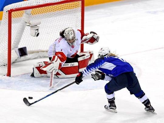 United States defenseman Emily Pfalzer (8) shoots the puck against Canada goaltender Shannon Szabados (1) in the women's ice hockey gold medal match during the Pyeongchang 2018 Olympic Winter Games at Gangneung Hockey Centre.