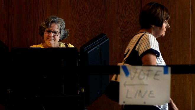 Sandra Leeper, left, votes at the Brentwood Library polling location on Thursday, August 2, 2018, in Brentwood, Tenn. The election will decide who will represent the Republican and Democratic parties in the November general election. The races include Governor, U.S. Senate and county commissioners.