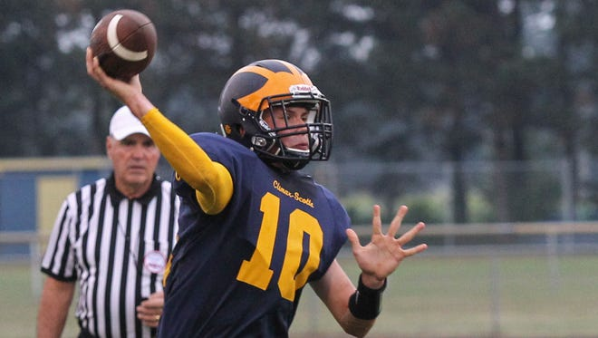 Ethan Vosburg of Climax-Scotts throws on the run against Athens.