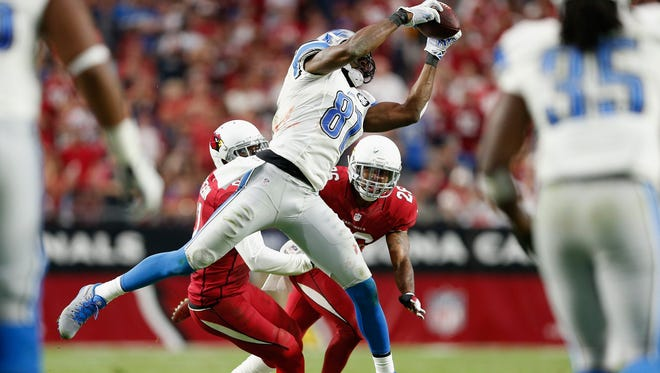 Wide receiver Calvin Johnson #81 of the Detroit Lions catches the football in the third quarter during the NFL game against the Arizona Cardinals at the University of Phoenix Stadium on November 16, 2014 in Glendale, Arizona.