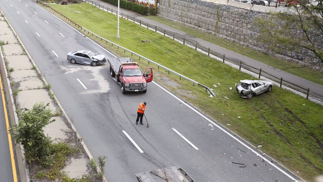 The aftermath of a two-car crash on the northbound Saw Mill River Parkway that killed 18-year-old Zachary Dunn of Yonkers on Sept. 5, 2016. Police said one car rear-ended a broken-down car, fatally injuring the driver of the broken-down car. Those in the other car left it behind and fled, police said.
