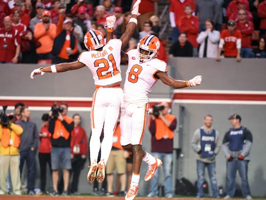 Clemson receivers Ray-Ray McCloud and Deon Cain.