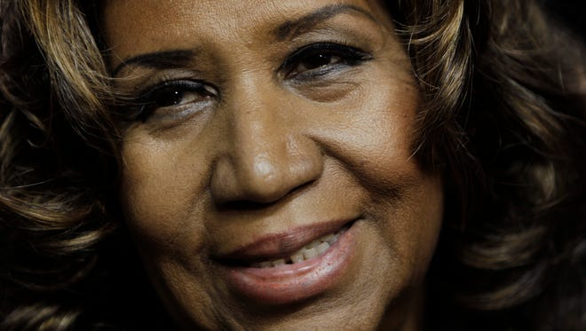 In this Feb. 11, 2011, Aretha Franklin smiles after the Detroit Pistons-Miami Heat NBA basketball game in Auburn Hills.