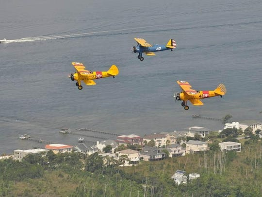 Stearmans fly over Gulf Breeze en route to Pensacola Beach in 2014.
