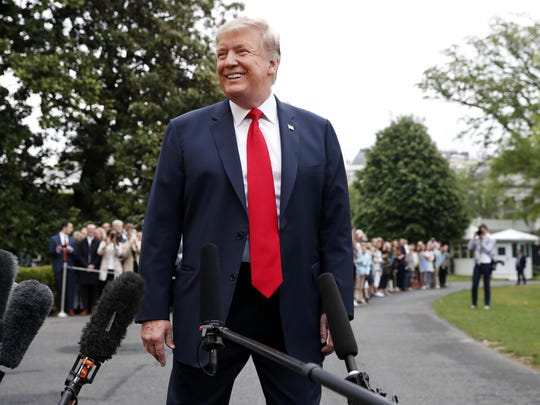 President Donald Trump smiles as he finishes speaking to the media as he departs the White House, Friday April 26, 2019, in Washington en route to Indianapolis where he is expected to speak at the annual meeting of the National Rifle Association.