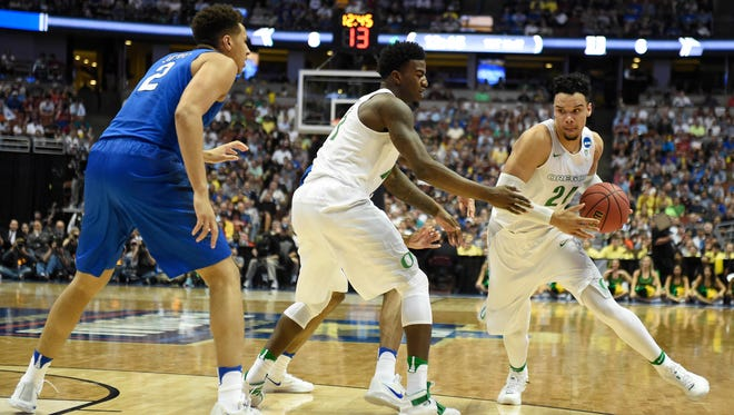 March 24, 2016; Anaheim, CA, USA; Oregon Ducks forward Dillon Brooks (24) moves the ball as forward Jordan Bell (1) blocks against Duke Blue Devils forward Chase Jeter (2) during the first half of the semifinal game in the West regional of the NCAA Tournament at Honda Center. Mandatory Credit: Richard Mackson-USA TODAY Sports