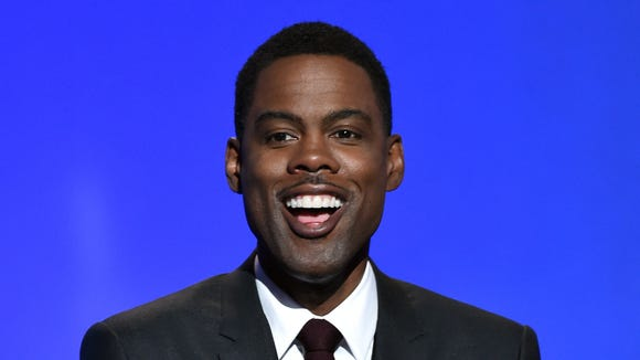 Chris Rock is under pressure to bow out as host of