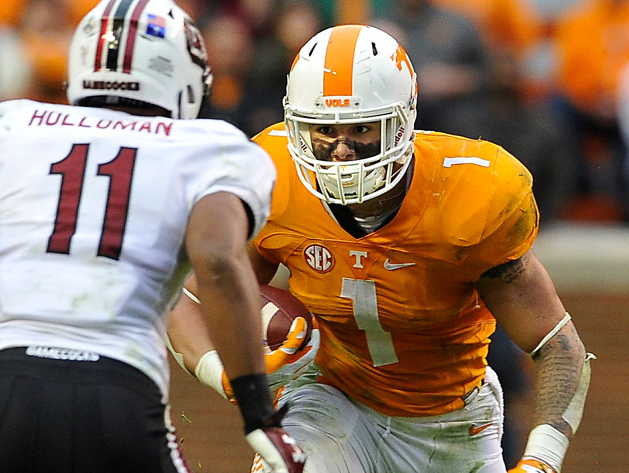 Tennessee running back Jalen Hurd (1) changes direction as he meets South Carolina Gamecocks linebacker T.J. Holloman (11) in Knoxville on Nov. 7.