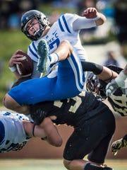 Duke quarterback Daniel Jones is tackled by Wake Forest
