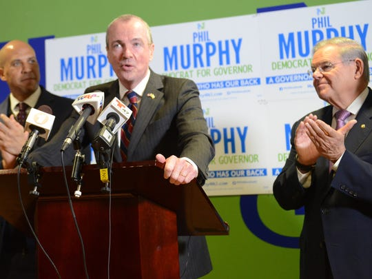 Democratic gubernatorial candidate Phil Murphy accepting endorsements from Sens. Cory Booker and Bob Menendez in Newark on Monday.