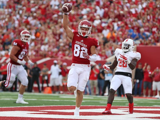 Luke Timian (82) receives a pass from Indiana Hoosiers quarterback Richard Lagow (21) for a touchdown at Indiana University's Memorial Stadium, September 10, 2016.