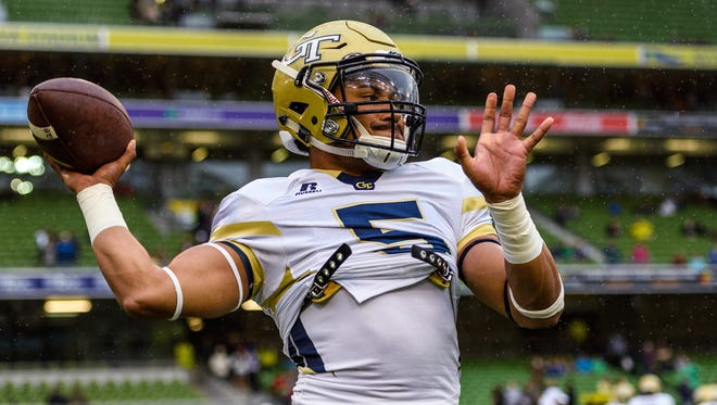 In this photo released by Georgia Tech, Georgia Tech Quarterback Justin Thomas (5) warms up before the first half of an NCAA football game between Boston College and Georgia Tech, Saturday, Sept. 3, 2016, in Dublin, Ireland. (Danny Karnik/Georgia Tech via AP)