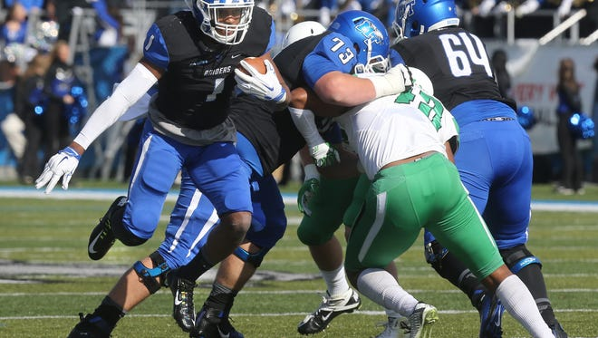 MTSU's Shane Tucker (1) runs the ball in the NCAA college football game against North Texas, on Saturday, Nov. 21, 2015, in Murfreesboro, Tenn.
