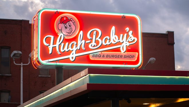 The exterior sign of Hugh-Baby's BBQ and Burger Shop