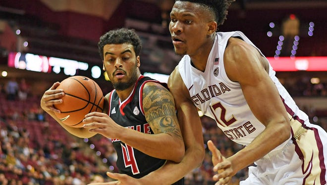 Jan 10, 2018; Tallahassee, FL, USA; Florida State Seminoles center Ike Obiagu (12) defends Louisville Cardinals guard Quentin Snider (4) during the first half of the game at Donald L. Tucker Center. Mandatory Credit: Melina Vastola-USA TODAY Sports