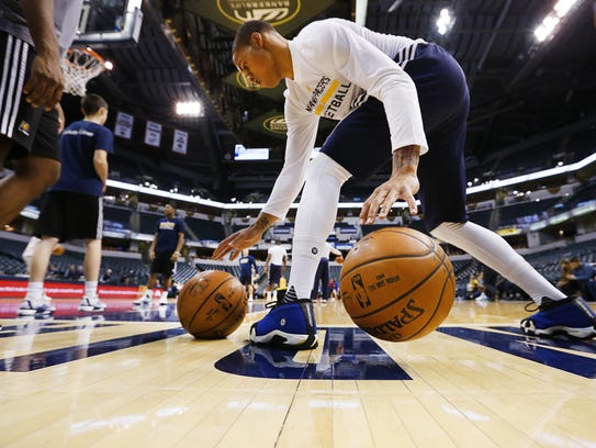 Indiana Pacers guard Joe Young works on his ball-handling