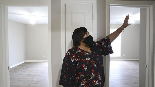 Kimberly Barganier is ready to move back into her house on Royal Oaks Court in Tuscaloosa after help from Habitat for Humanity of Tuscaloosa helped her complete renovations after a fire drove her from her home three years ago. Barganier gestures in her hallway Friday, July 24, 2020, as she describes how and where the fire started three years ago.