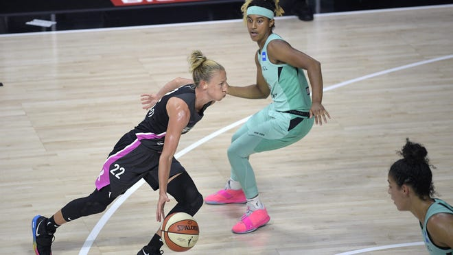 Chicago Sky guard Courtney Vandersloot (22) drives to the basket in front of New York Liberty guard Paris Kea, right, during the second half of a WNBA basketball game, Tuesday, Aug. 25, 2020, in Bradenton, Fla.