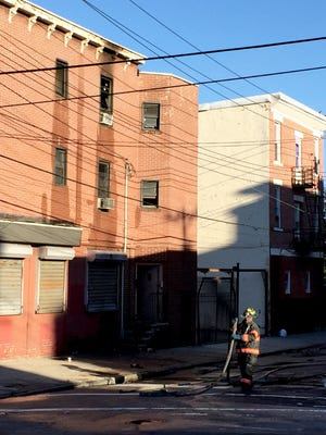 Firefighters on the scene of a third-floor apartment fire at 23 Park Hill Ave. in Yonkers, Oct. 6, 2015.