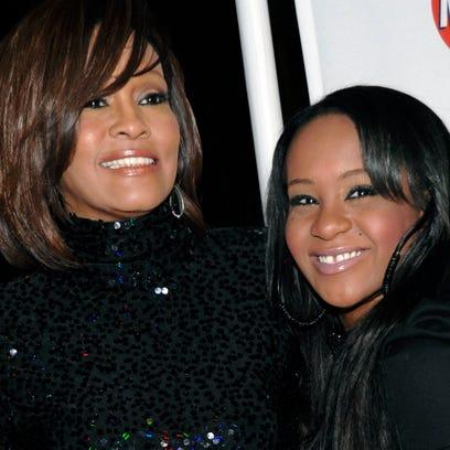 In this Feb. 12, 2011, photo, singer Whitney Houston,