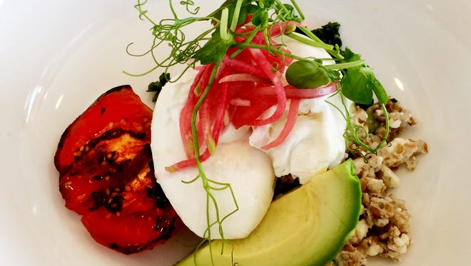 Cafe Roze: The Egg Bowl with poached eggs, cucumber-feta bulghur, preserved lemon yogurt, grilled tomato, kale and avocado