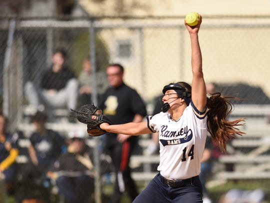 Paramus Catholic and Ramsey softball teams play during