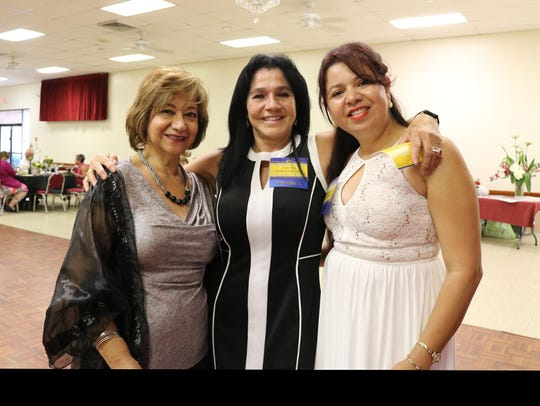 Sara Marut, left, Maria Allen and Julisa Aguilar, members
