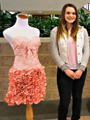 Sarah Hansen stands beside her 2014 Upcycled Glam dress.