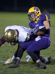 Hagerstown's Brandon Purtha runs the ball against Indianapolis