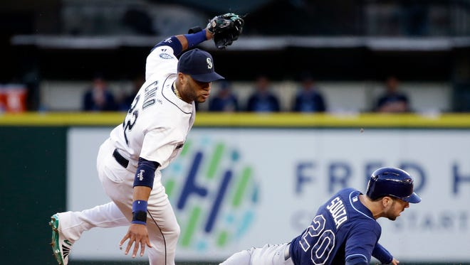 Seattle Mariners second baseman Robinson Cano, left, is tripped by the feet of Tampa Bay Rays' Steven Souza Jr. as Souza slides into second base after being forced out in the fourth inning of a baseball game Thursday, June 4, 2015, in Seattle. Jake Elmore was safe at first and a run scored on the play.