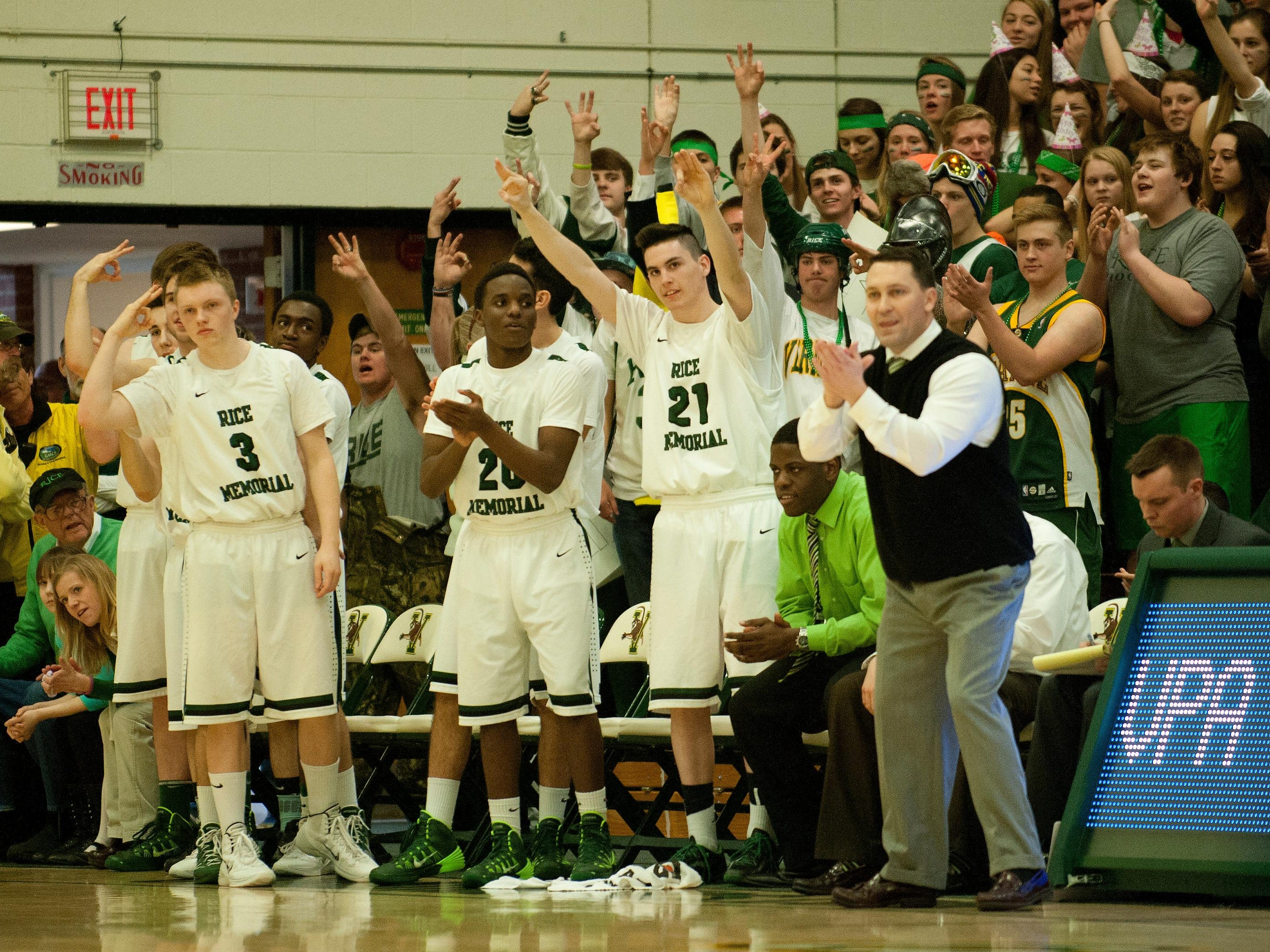 The Rice bench cheers for the team during the 2014 division I boys basketball championship game between the Mount Mansfield Cougars and the Rice Green Knights at Patrick Gym on Saturday afternoon March 8, 2014 in Burlington, Vermont. (BRIAN JENKINS, for the Free Press)