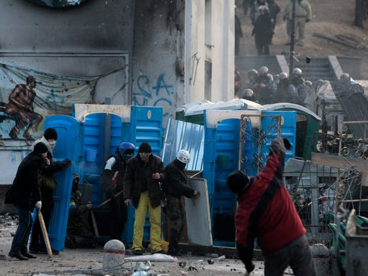 Ukraine protesters use portable toilets as barricades