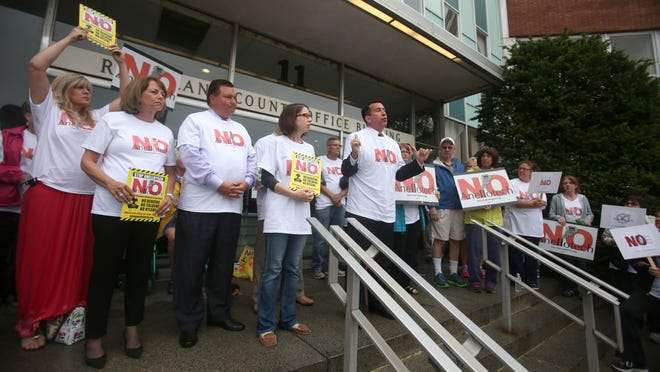 Attorney Brian Condon, center, speaks at a rally at the Allison-Parris Rockland County office building in New City. He is representing a group opposed to the planned Anellotech building in Pearl River June 15, 2015.