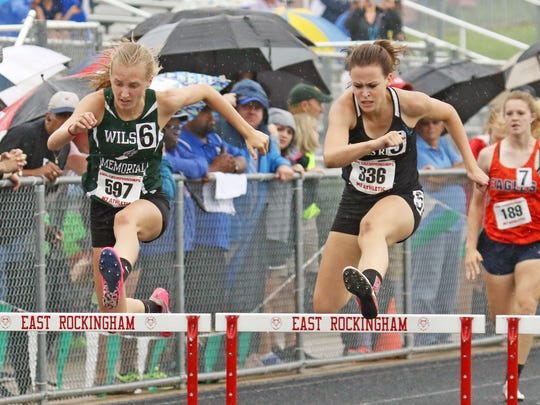 Wilson Memorial's Paige Miller passes James River's Katelyn Wiley on the final hurdle to win the Class 2 girls 300-meter hurdles at the VHSL Class 1 & 2 state track and field championships at East Rockingham High School in Elkton on Saturday, June 2, 2018.