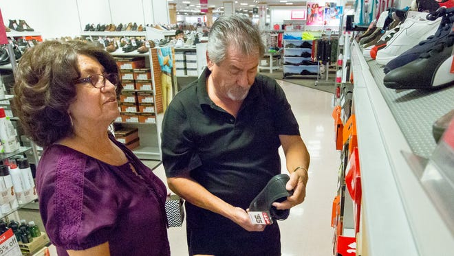 Manuel and Berlinda Pino, of Alamogordo, New Mexico, shop for shoes in JCPenney on Tuesday May 3, 2016.