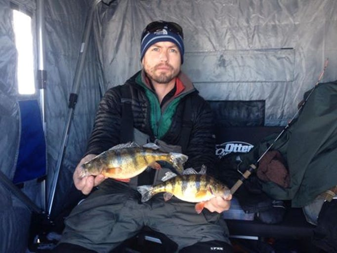 Greg Sewall with a perch caught with guide Phil Schweik