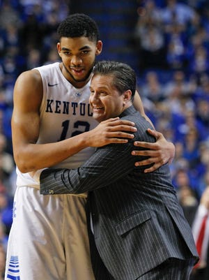 Kentucky's Karl-Anthony Towns gets a hug from Coach John Calipari Tuesday night at Rupp Arena in Lexington. Towns owns scored 15 points as well as a team high 13 rebounds in the Wildcats' 69-58 win over the Bulldogs. By Matt Stone, The Courier-Journal February 3, 2015
