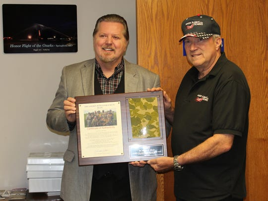 Robert O'Block, left, accepts an award from Honor Flight of the Ozarks in 2016.