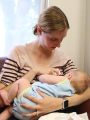 Deborah Mitchell of Tappan breastfeeds her son Jamie