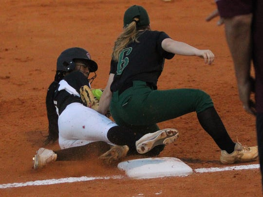 Chiles' Lamari White is called safe on a tag play at third though Lincoln third baseman Shelby Sloan had the ball and applied the tag in time.
