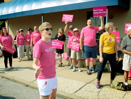 Planned Parenthood Keystone grass roots organizer Arissa Brown leads a chant with supporters during a rally outside the York City branch Thursday, Sept. 3, 2015. About 50 supporters turned out for the event which included a speech by Sari Stevens, director of Planned Parenthood Pennsylvania Advocates. Bill Kalina - bkalina@yorkdispatch.com