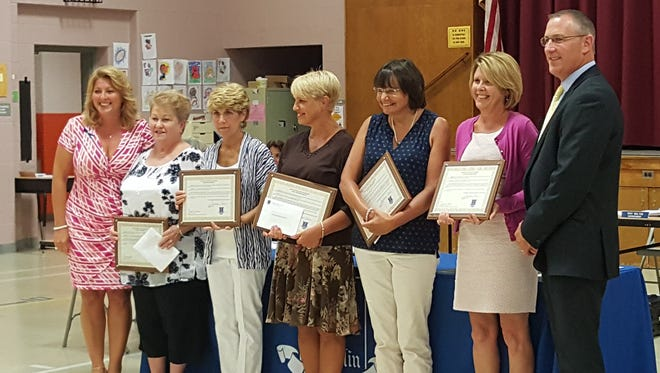 (From left) Board of Education President Stephanie Starr; retirees Sylvia Alminda, Deborah Burrell, Rose Marie Herman, Donna Reichard and Jane Rickershauser; and Superintendent Troy Walton at the Franklin Board of Education's Sept. 16 meeting, where the district's 2014-15 retirees were recognized.