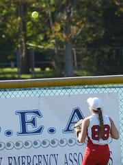 Laurel outfielder watch's a home run ball hit by Cape's Sydney Ostroski goes over the fence as Cape Henlopen hosted Laurel at the school near Lewes on Thursday.